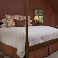 Malena's Tango queen suite offers an antique curly maple four-poster bed