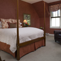Malena's Tango queen suite - a queen antique bed with window views of the landscape and grounds
