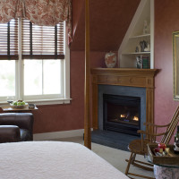 Malena's Tango queen suite offers a sitting area near a gas fireplace with window views of the gardens