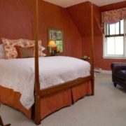Jackson House Inn -Malena's Tango queen suite with antique four-post curly maple bed